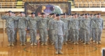 The Salem National Guard unit gives a salute at their deployment ceremony Saturday, August 23 at Salem Community High Sc